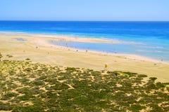 Beach Playa de Sotavento. Fuerteventura, Spain - 16.02.2017. Aerial view on the beach Playa de Sotavento with unknown people. Fuerteventura, Spain - 16.02.2017 Royalty Free Stock Photo