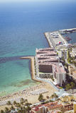 Beach Playa del Postiguet and the hotel Melia Alicante Stock Image