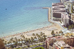 Beach Playa del Postiguet and the hotel Melia Alicante. ALICANTE, SPAIN - SEPTEMBER 9, 2014:  view of the beach Playa del Postiguet and the hotel Melia Alicante Royalty Free Stock Photography