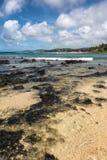 The beach of Poipu, Kauai. A view of a beach along Poipu coast Royalty Free Stock Images