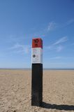 Beach pole at the Dutch coast. Typical Dutch beach pole at the coast of Ouddorp, Netherlands. These poles are found all along the Dutch coast. As they are all Royalty Free Stock Photo