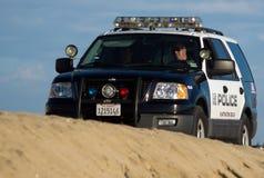 Beach-Polizei setzt Patrouille auf den Strand Stockbild