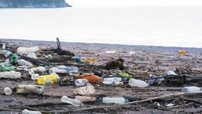 Beach polluted with plastic bottles. Time lapse stock video