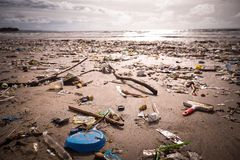 Beach polluted with plastics and waste stock images