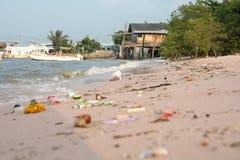 Beach pollution. So many trashes. On sea beach Royalty Free Stock Photo