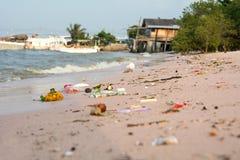Beach pollution. So many trashes on sea beach Royalty Free Stock Photos