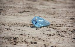 Beach pollution. Plastic bottle on the sand Stock Photo