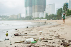 Beach pollution. Plastic bottles and other trash on sea beach Royalty Free Stock Images