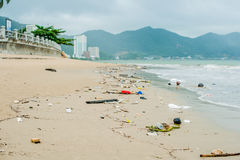 Beach pollution. Plastic bottles and other trash on sea beach Royalty Free Stock Photography