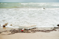 Beach pollution. Plastic bottles and other trash on sea beach Royalty Free Stock Photos