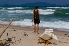 Beach pollution, plastic and waste from ocean on the beach. tourist on the polluted beach. stock photos