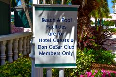 Beach & Pool Facilities sign on Pool area in The Don Cesar Hotel. St. Pete Beach, Florida. January 25, 2019 . Beach & Pool Facilities sign on Pool area in The royalty free stock photo