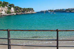 Beach in Porto Cristo. With turquoise water and blue sky on a sunny summer day in Mallorca, Balearic islands, Spain Stock Image