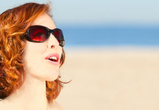 Beach portrait. Excited surprised girl with sunglasses on the beach Stock Image