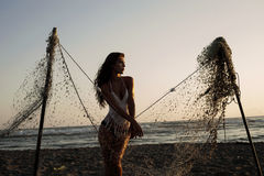 Beach portrait behind fishing net Stock Photography