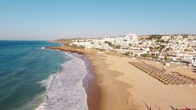 Beach of Praia da Luz at morning, Lagos, Algarve, Portugal aerial view stock video footage