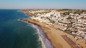 Beach of Praia da Luz at morning, Lagos, Algarve, Portugal aerial view stock video