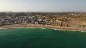 Beach of Praia da Luz at morning, Lagos, Algarve. Beach of Praia da Luz at morning, Lagos, Algarve, Portugal aerial view stock footage