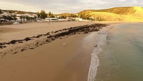Beach of Praia da Luz at sunset, Lagos, Algarve, Portugal aerial view stock footage