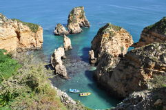 Praia da Piedade, Algarve, Portugal, Europe. Beach Praia de Piedade, Algarve, Portugal, Europe, with two boats Stock Photography