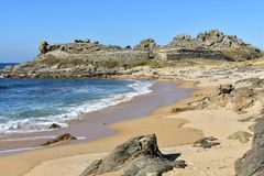 Beach and prehistoric settlement ruins. Castro de Baroña, Coruna, Spain. Castro de Barona, La Coruna Province, Galicia, Spain. Wild beach and prehistoric royalty free stock photography