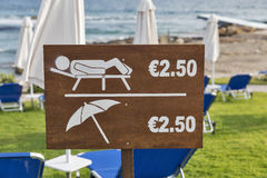 Beach price label for sunbeds and umbrellas closeup Royalty Free Stock Images