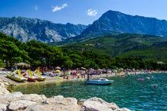 Beach in Promajna, Croatia. Promajna, Croatia - July 11, 2018: Vacationers on the public beach of the town of Promajna royalty free stock images