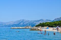 Beach in Promajna, Croatia. Promajna, Croatia - July 11, 2018: Vacationers on the public beach of the town of Promajna stock photos