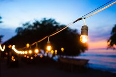 Beach promenade at night with party lights. Beach promenade at sunset with party lights stock photography