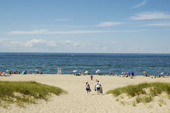Beach in Ptown. A photo of some beachgoers and the view at Provincetown MA royalty free stock image