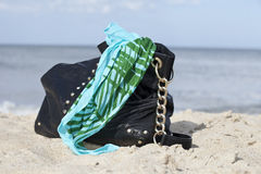 Beach and Purse. Purse on the beach with scarf Royalty Free Stock Photo