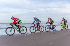 Beach racing bike competition riders in beach race in The Hague, the Netherlands. Kijkduin, The Hague, the Netherlands - 28  January 2018: Beach racing bike Stock Photography
