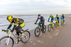 Beach racing bike competition riders in beach race in The Hague, the Netherlands. Kijkduin, The Hague, the Netherlands - 28  January 2018: Beach racing bike Royalty Free Stock Photography