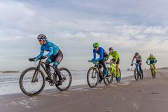 Beach racing bike competition riders in beach race in The Hague, the Netherlands. Kijkduin, The Hague, the Netherlands - 28  January 2018: Beach racing bike Royalty Free Stock Image