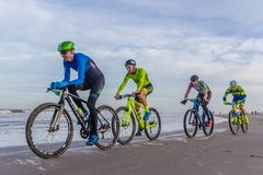Beach racing bike competition riders in beach race in The Hague, the Netherlands. Kijkduin, The Hague, the Netherlands - 28  January 2018: Beach racing bike Royalty Free Stock Photo