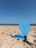Beach Rackets. Blue Beach Rackets on Sand at The Beach Royalty Free Stock Photography