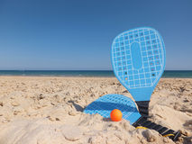 Beach Rackets. Blue Beach Rackets on Sand at The Beach Royalty Free Stock Photos