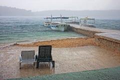 Beach in the rain. Beach chairs in the rain, selective focus Stock Photo