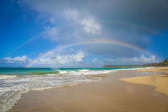 Beach. Rainbow on the Atlantic ocean Stock Photography