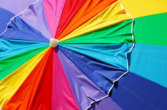Beach rainbow umbrella Royalty Free Stock Photo