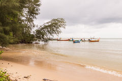 Beach on rainy season with some local fishing boats before raini. Ng, South of Thailand royalty free stock photos