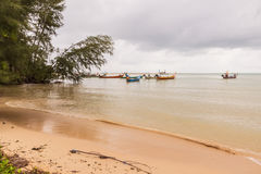 Beach on rainy season with some local fishing boats before raini. Ng,  South of Thailand Royalty Free Stock Photography