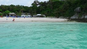 Beach of Raya Island, Thailand. Tourists in the water on the beach of Koh Racha Yai Island stock video