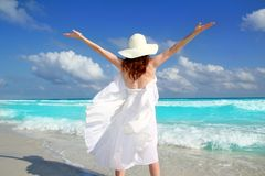 Beach rear woman wind shaking white dress Stock Photos