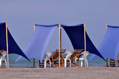 Beach recliners and canopy at beach Stock Photos