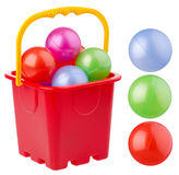 Beach red bucket with colored balls Royalty Free Stock Photos