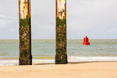 Beach with red eyecatcher and two columns. Beach with red eye-catcher and two columns in Vlissingen in Zeeland Holland atmosphere with pleasant light Royalty Free Stock Image