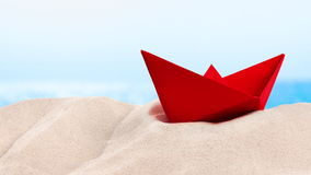 On the Beach - red paper boat on a sand dune in front of beautiful azure sea on a sunny day  - seamless loop - ProRes stock video footage