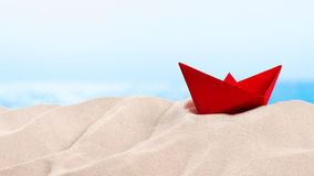 On the Beach - red paper boat on a sand dune in front of beautiful azure sea on a sunny day  - seamless loop - ProRes stock footage