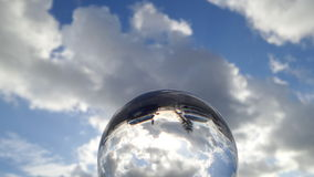 Beach reflected in crystal sphere white car sunrise Royalty Free Stock Image